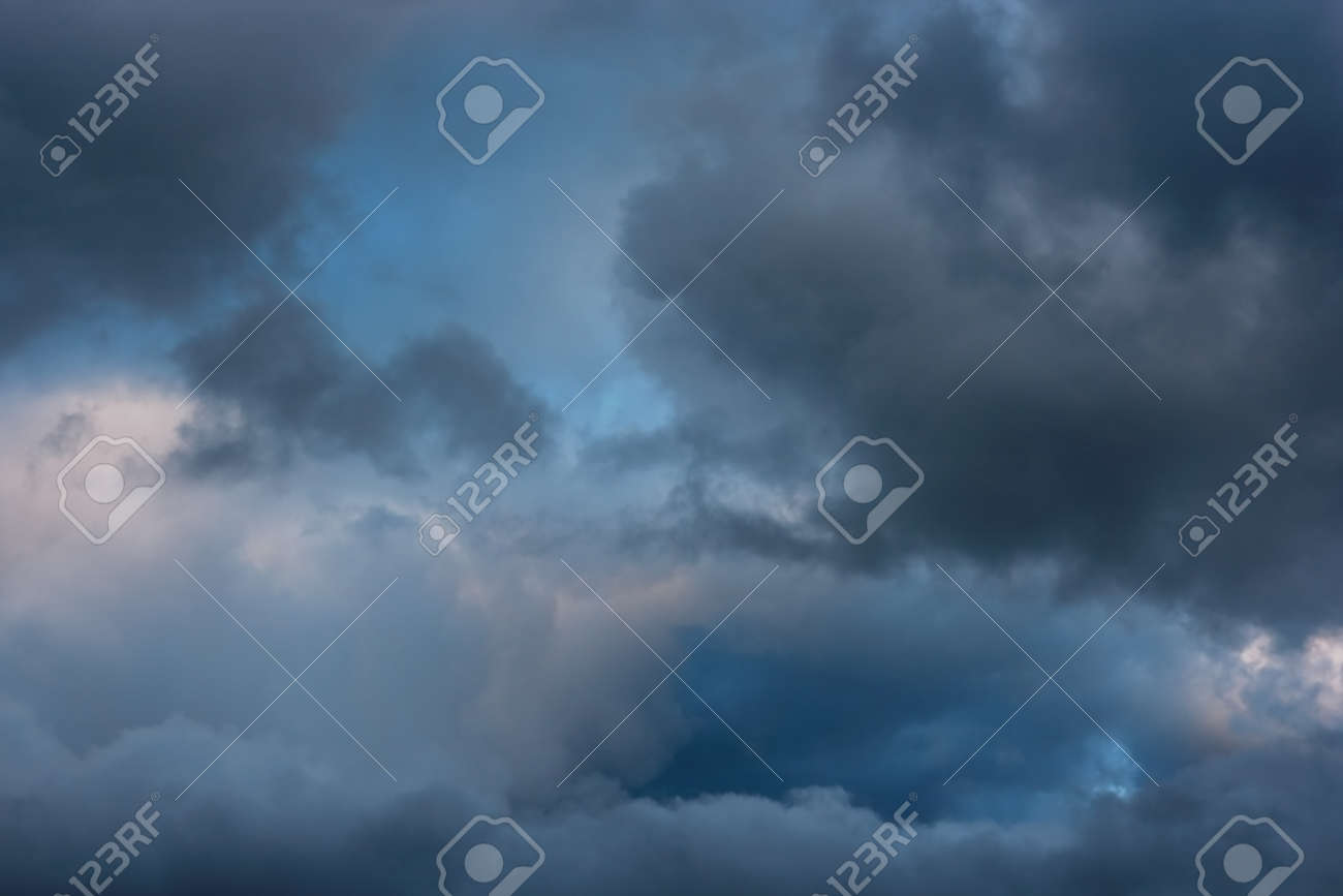 Stormy clouds on spring evening  Rainy cloudy sky before the storm Stock Photo - 17544848