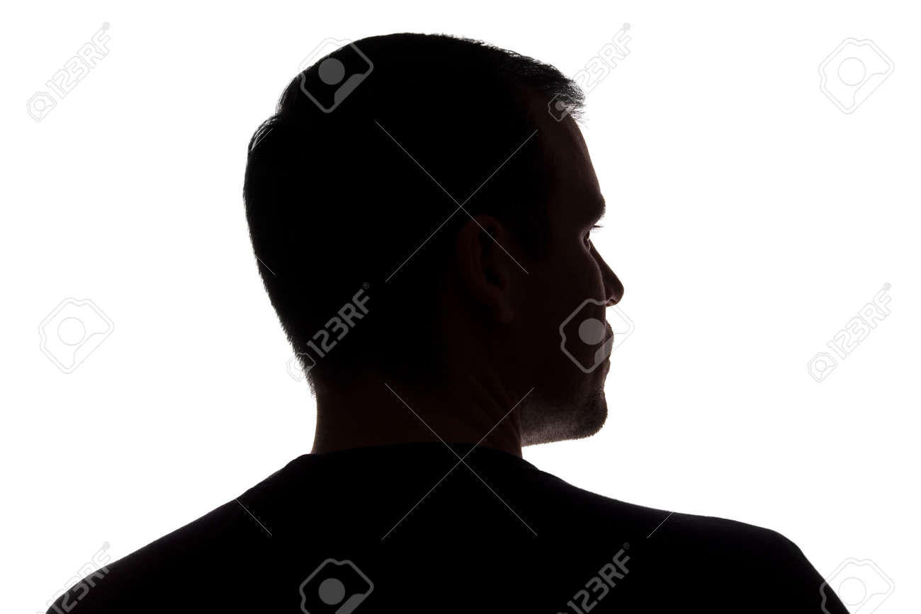 Portrait of a young man, unshaven, back view - dark isolated silhouette - 151435316