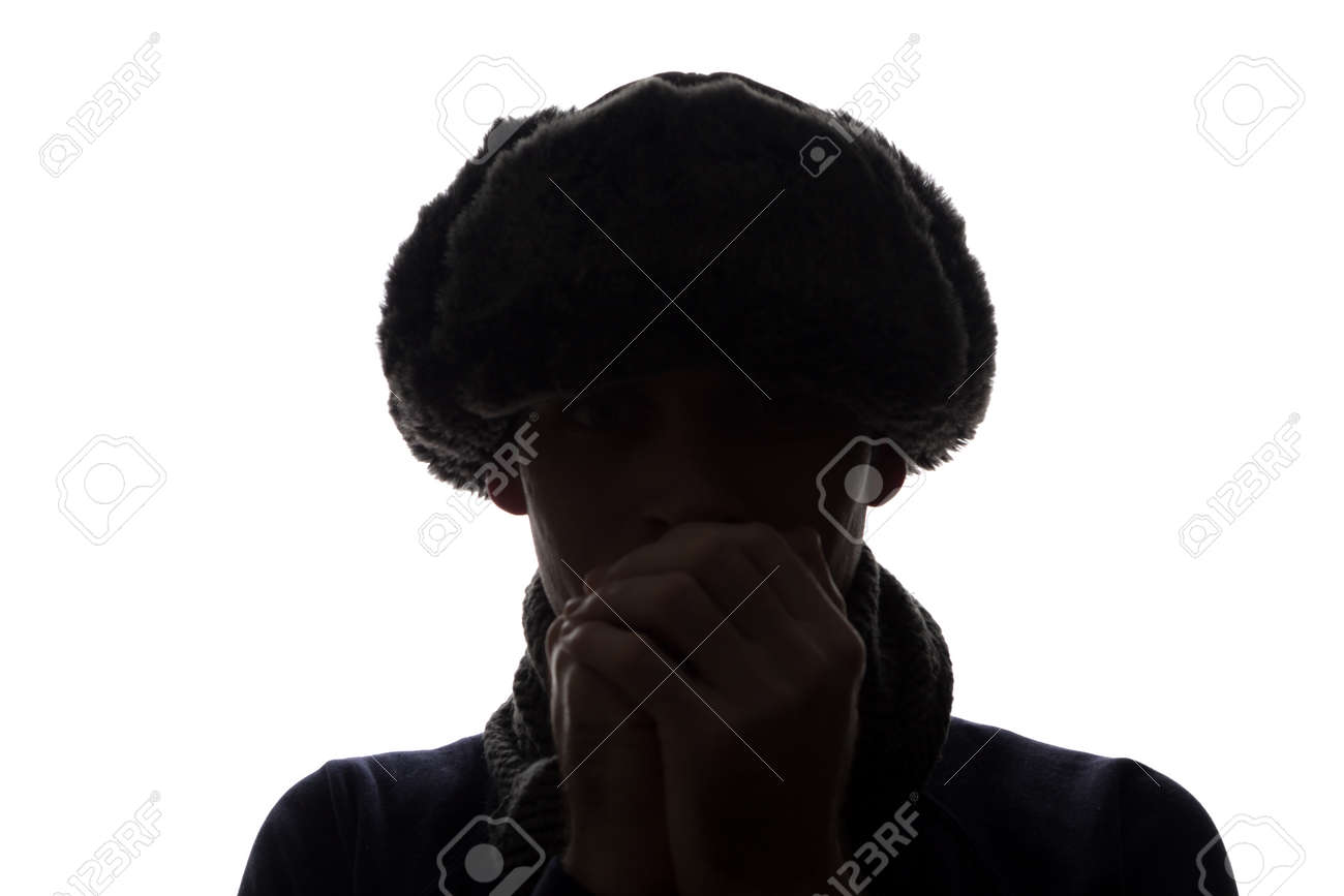 Young man in hat and gloves look ahead - horizontal silhouette of a front view - 151800705