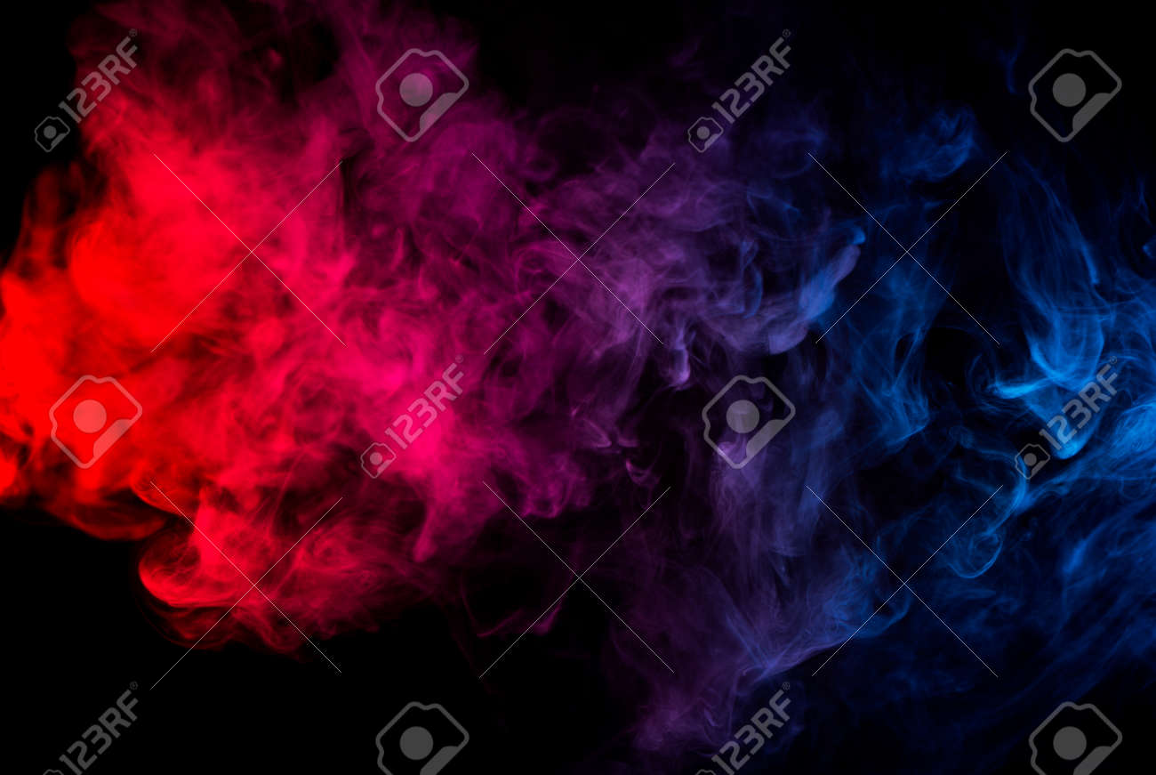 Abstract Shapes Of Mixed Colors Of Blue And Red Smoke At Dark