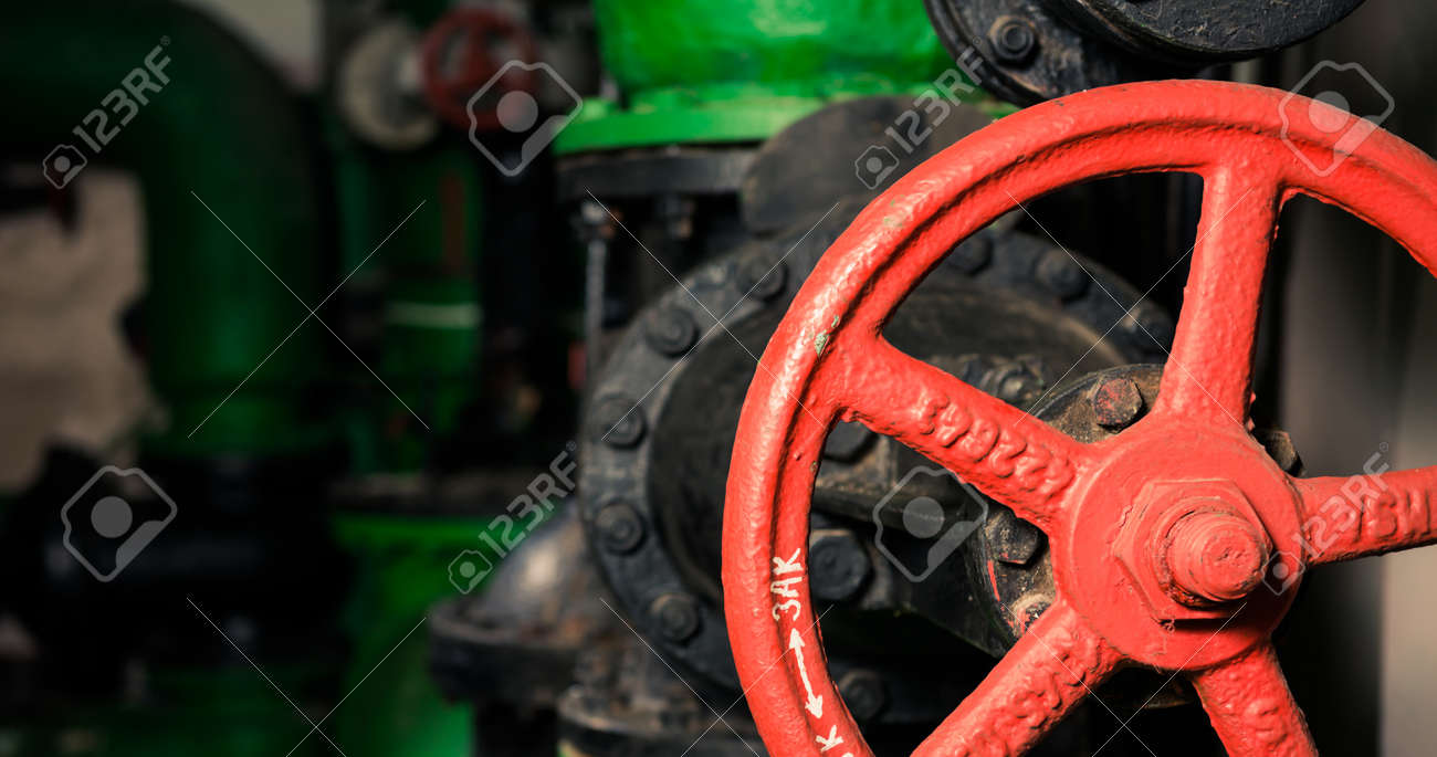 water supply pipes with red valves - 116678583