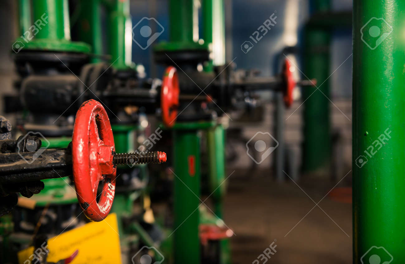 water supply pipes with red valves - 116678590