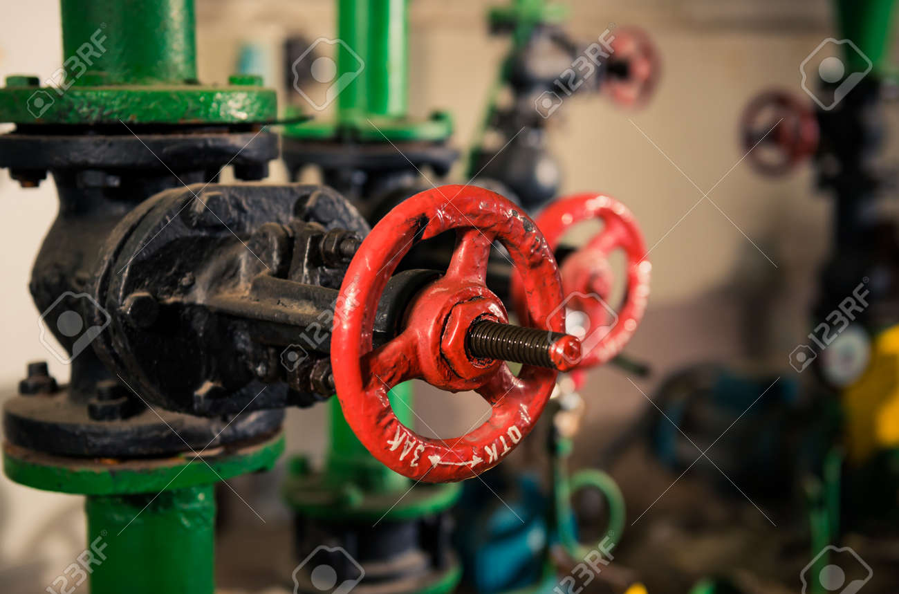 water supply pipes with red valves - 116678589