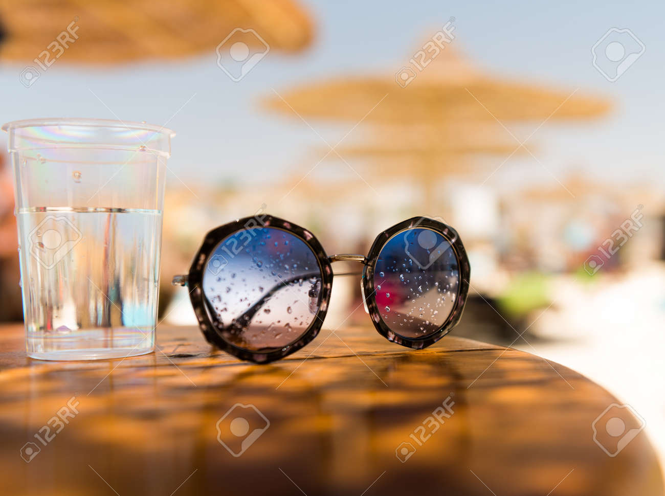 sunglasses on summer wooden table - 127951891