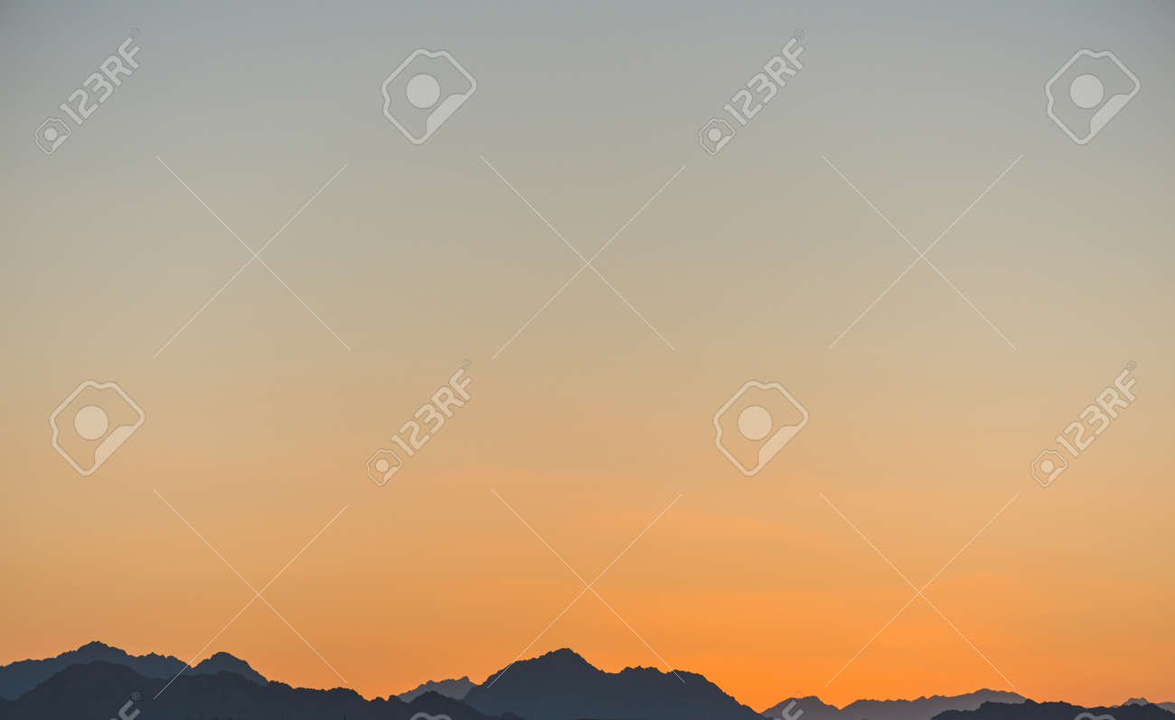sunset line over mountains - 127951893