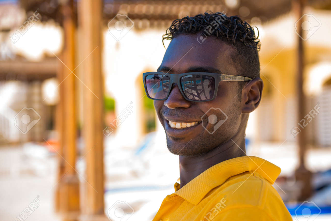 Egypt, Hurghada - 07/16/2020. smiling portrait of egyptian hotel staff lifeguard worker at swimming pool area on background - 154118509