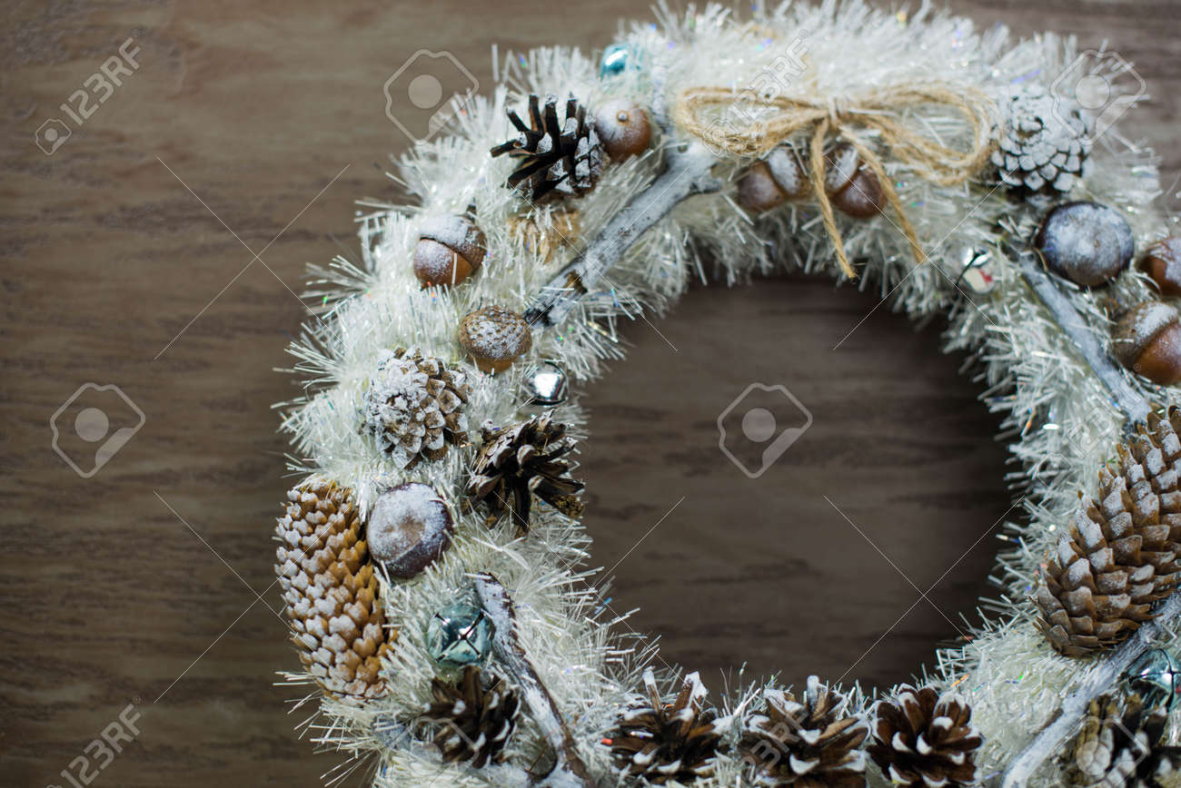 beautiful white Christmas wreath on brown wooden background - 160616116