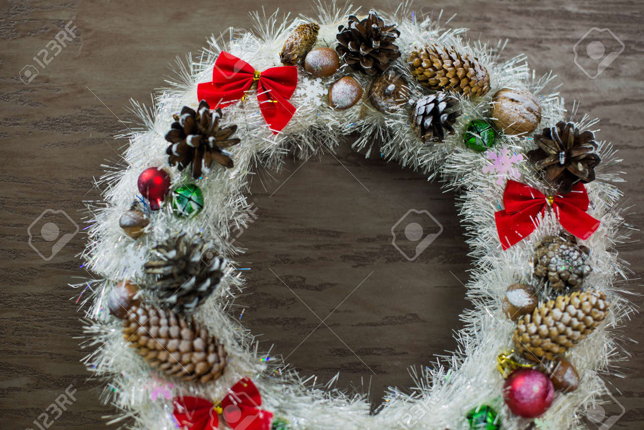beautiful white Christmas wreath on brown wooden background - 160615634