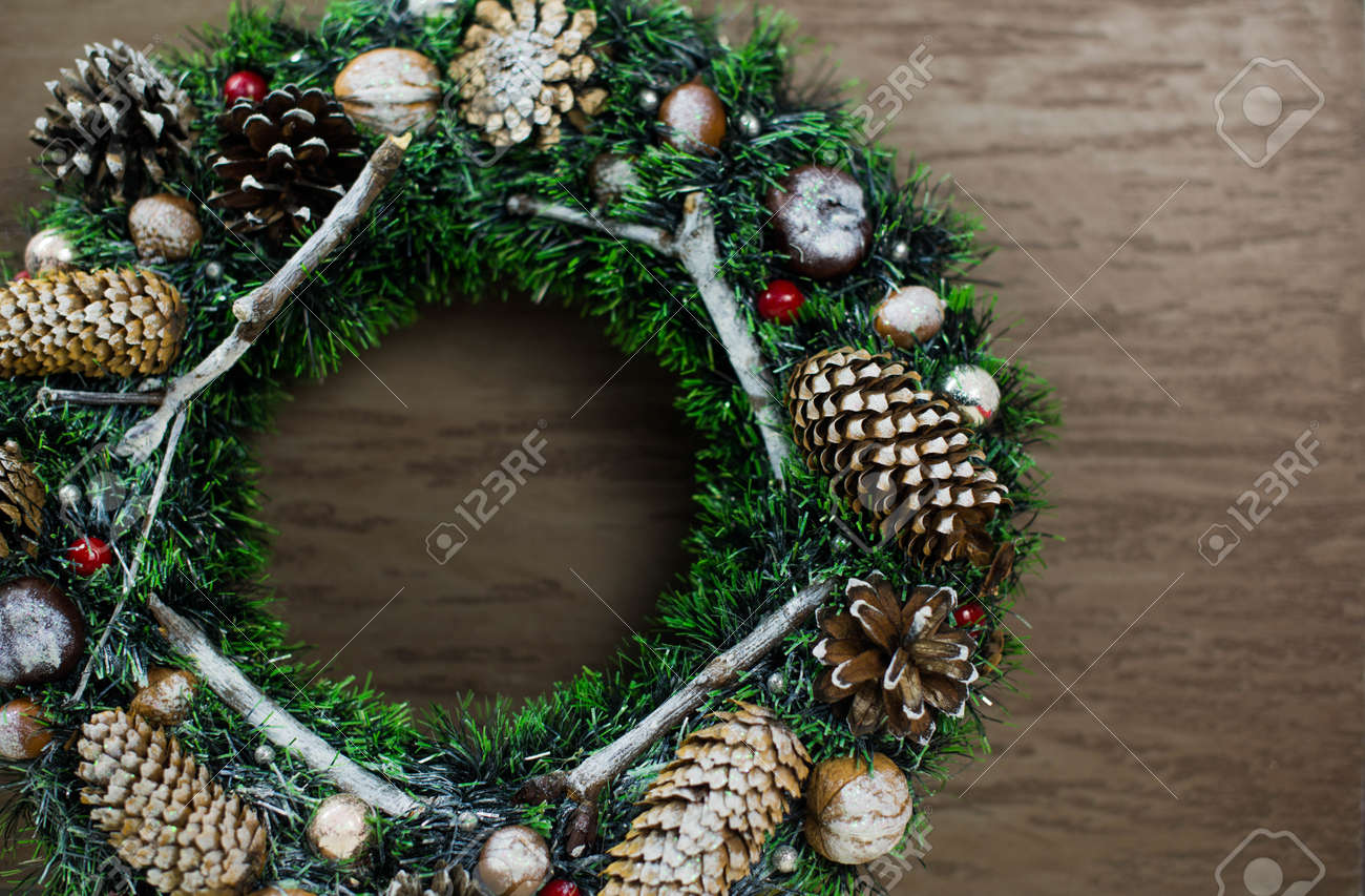 beautiful green Christmas wreath on brown wooden background - 160615733