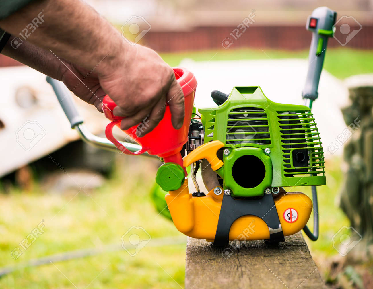 grass-cutter preparing to work on spring farmland soil - 169122092