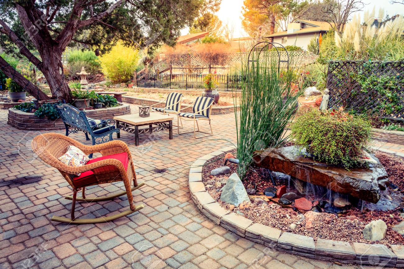 Evening on a patio in a tranquil garden Stock Photo - 45248024