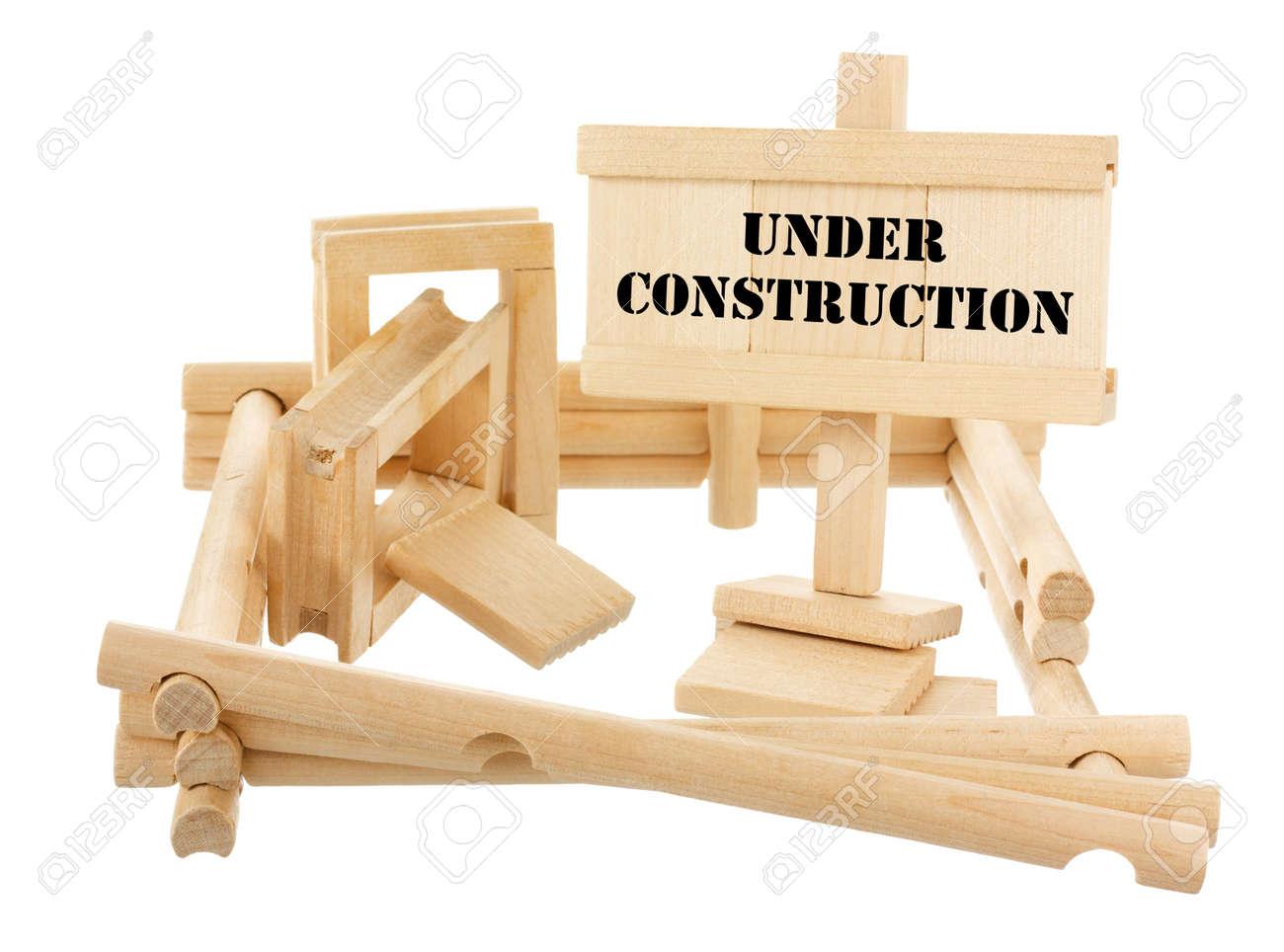 Under construction unfinished wooden house isolated on white Stock Photo - 13824110