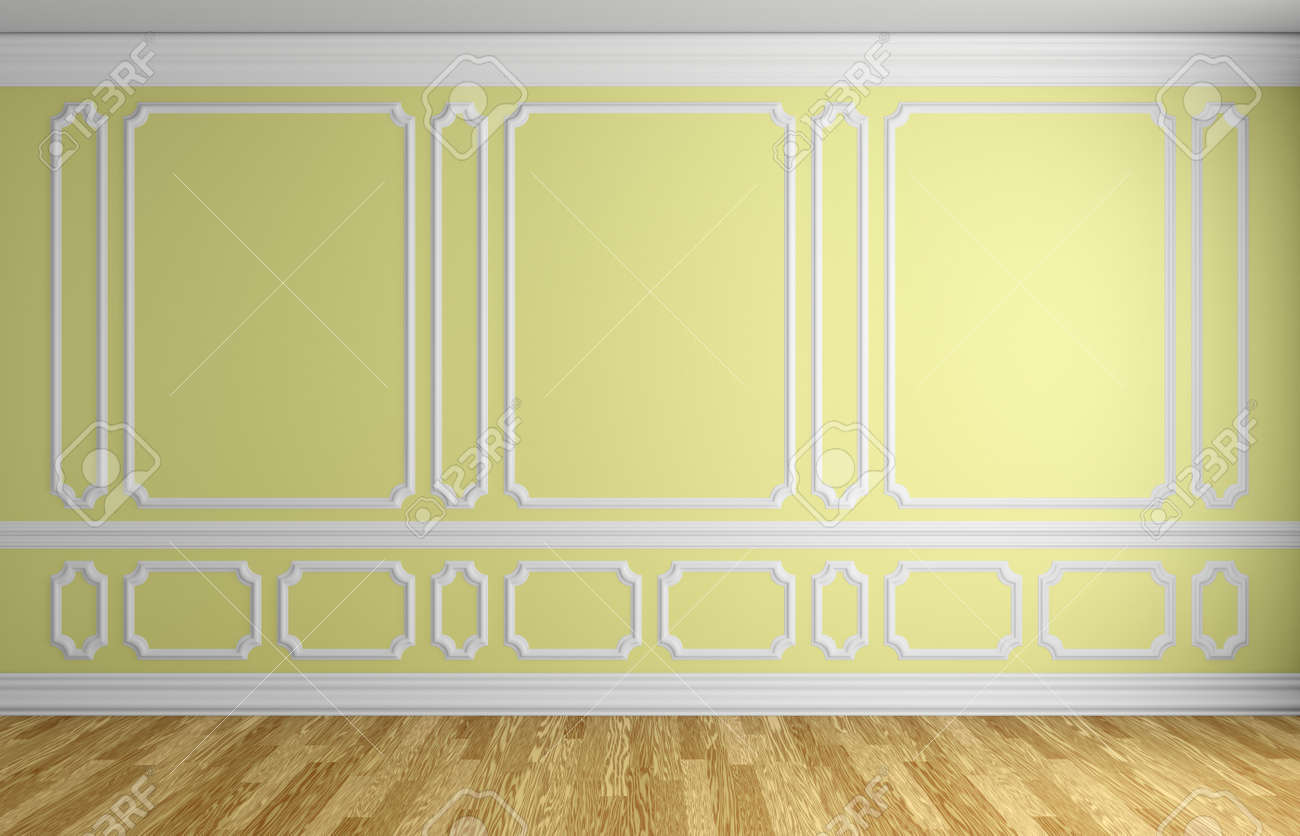 Yellow Wall With White Decorative Moldings Elements On Wall In ...