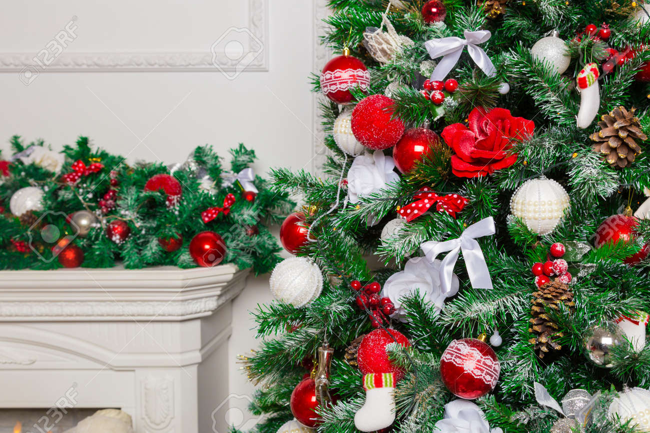 Christmas Tree Bows Red.Beautiful Christmas Tree Decorated With Red And White Balls
