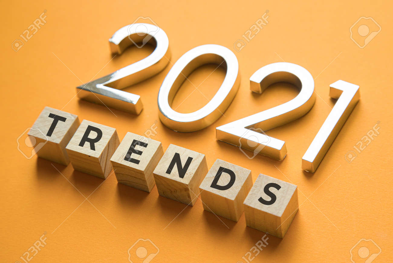 Wooden blocks with the word Trends and metal numbers 2021. Popular , relevant topics. New trends of fashion. - 151933030