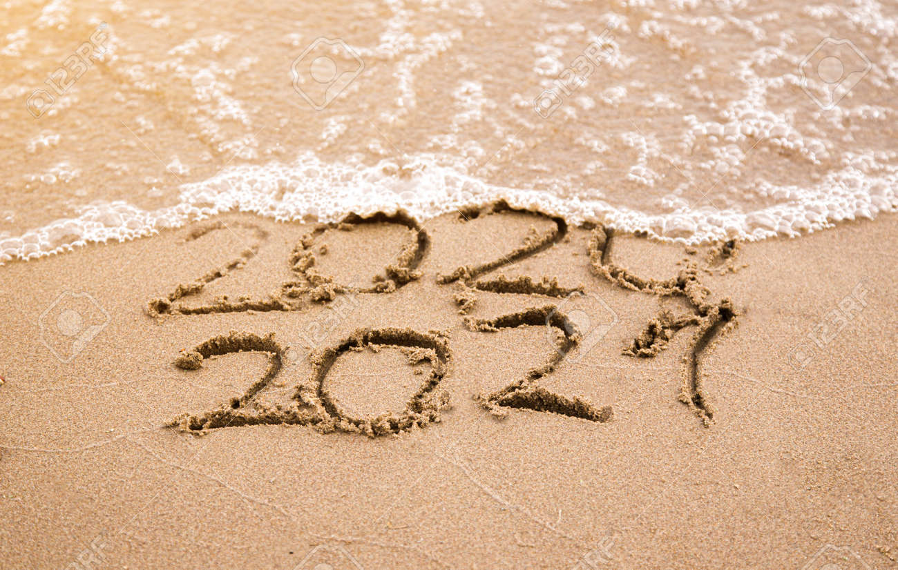 Change Year 2020 To 2021 On Sand Beach. Ocean Wave And Lettering.. Stock  Photo, Picture And Royalty Free Image. Image 152994689.