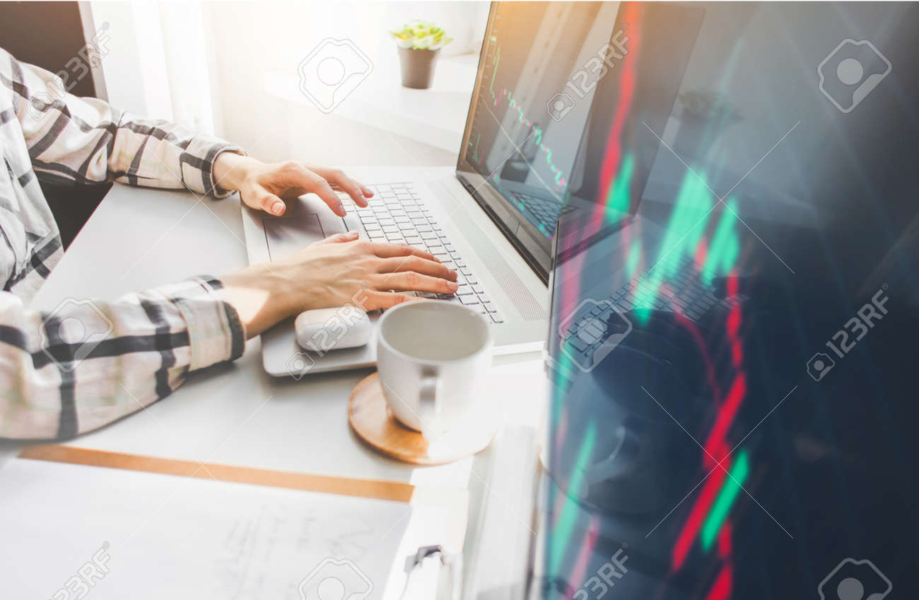 Woman Investor analyzing stock market investments with financial dashboard, business intelligence, and key performance indicators on computer screens - 166734873