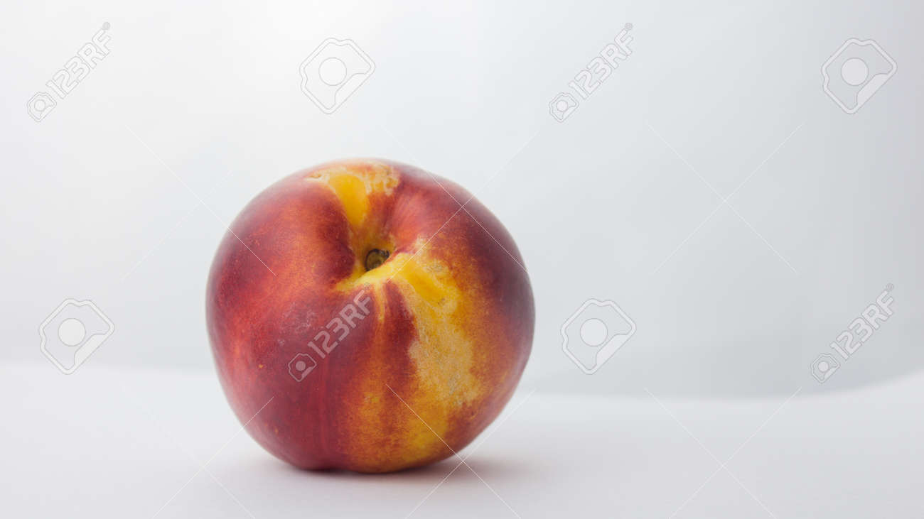 Fresh juicy peaches on a white plate. Close-up Fresh organic peaches nectarine on a white plate. - 152947788