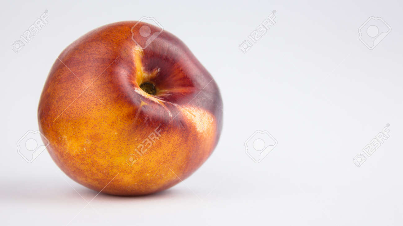 Fresh juicy peaches on a white plate. Close-up Fresh organic peaches nectarine on a white plate. - 152947792