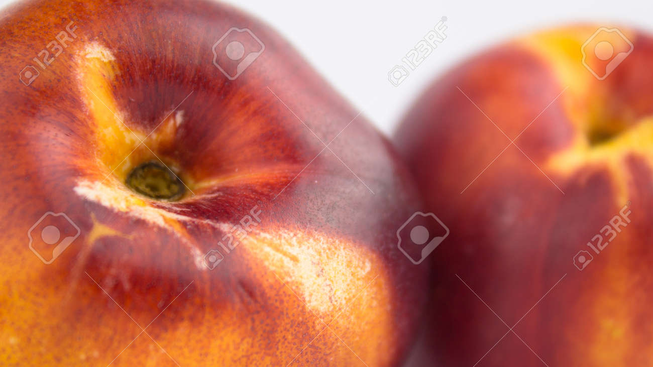 Fresh juicy peaches on a white plate. Close-up Fresh organic peaches nectarine on a white plate. - 152883535