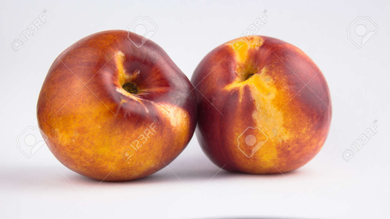 Fresh juicy peaches on a white plate. Close-up Fresh organic peaches nectarine on a white plate. - 152947793