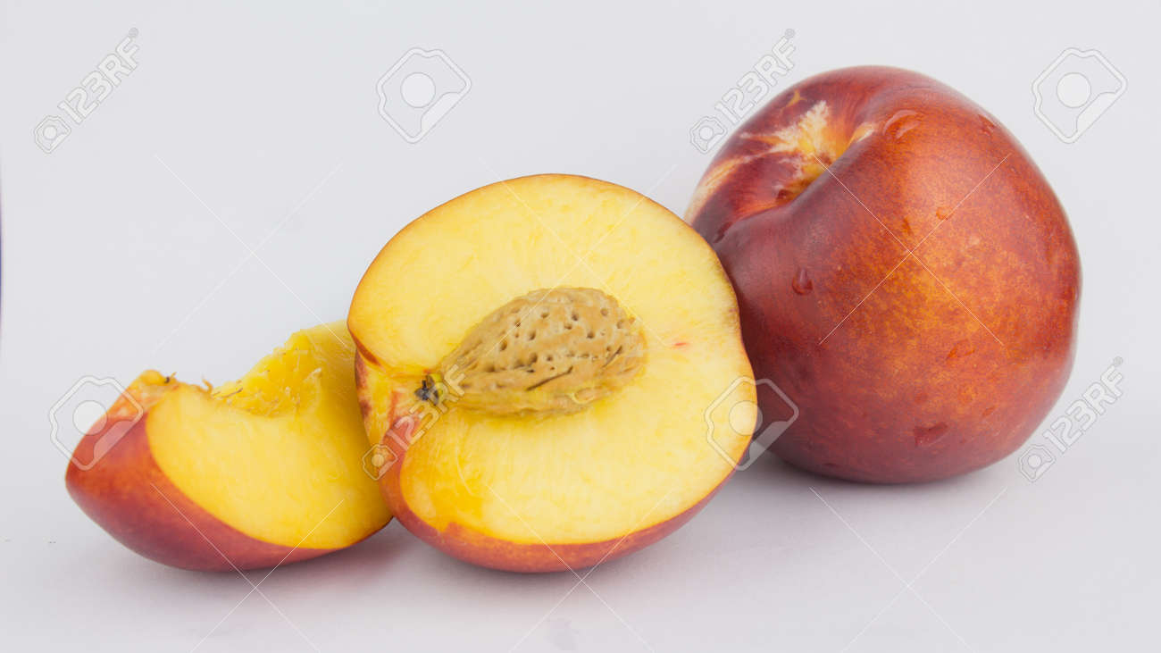 Fresh juicy peaches on a white plate. Close-up Fresh organic peaches nectarine on a white plate. - 152883450
