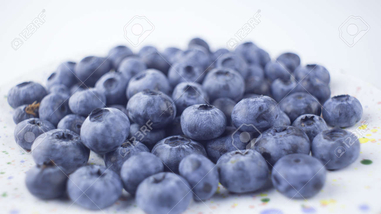 Close-up of ripe juicy blueberries on a white background. - 152883613