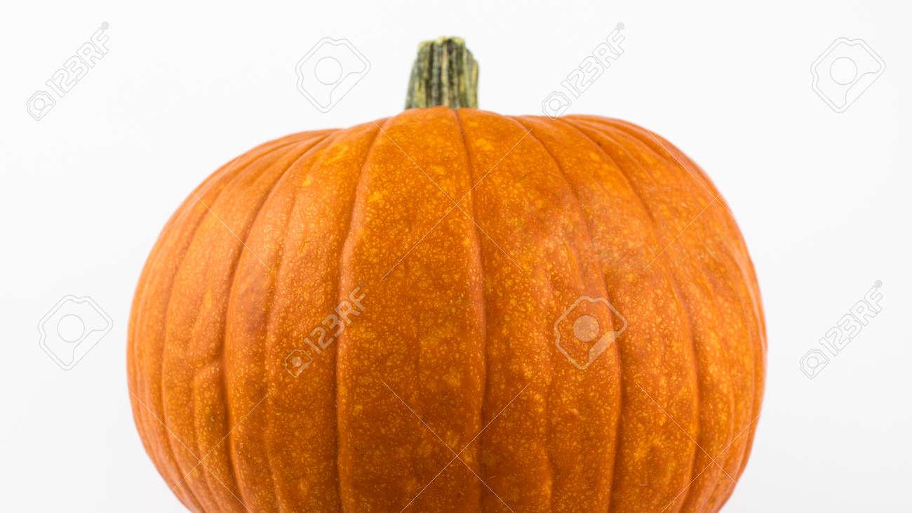 Halloween pumpkin on a white background. Ripe orange pumpkin on a white background. Fresh organic pumpkin on a white background. - 155328192