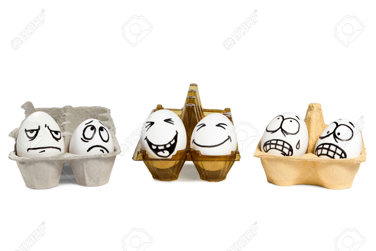 Two eggs with funny faces in a plastic tray, and next to them four eggs with angry faces in paper trays isolated on white background - 38605416