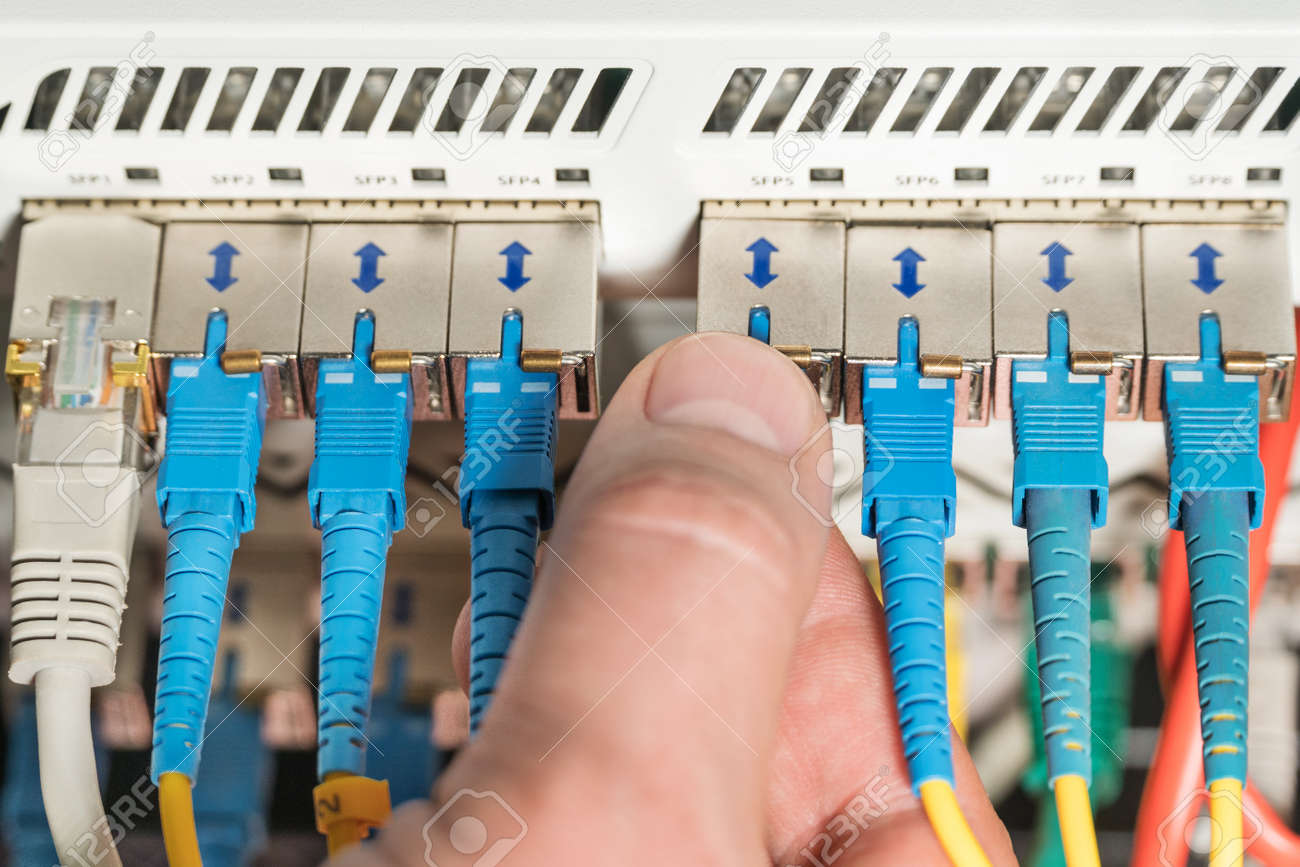 Man Hand Connects The Wire To The Router, Close-up Stock Photo ...