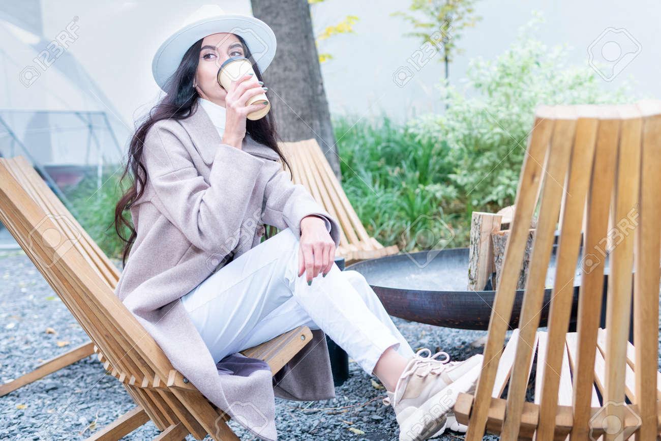 portrait of woman drinking coffee - 171754912