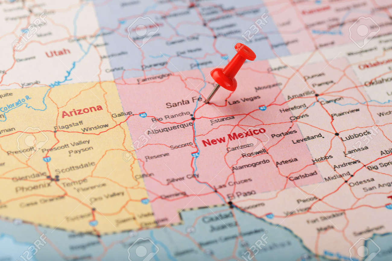Red clerical needle on a map of USA, New Mexico and the capital.. on boca raton on us map, helena on us map, greensboro on us map, madison on us map, pikes peak on us map, knoxville on us map, st. louis on us map, savannah on us map, manchester on us map, natchitoches on us map, pierre on us map, new orleans on us map, los angeles on us map, grand rapids on us map, new york on us map, boise on us map, scottsdale on us map, denver on us map, boulder on us map, san antonio on us map,