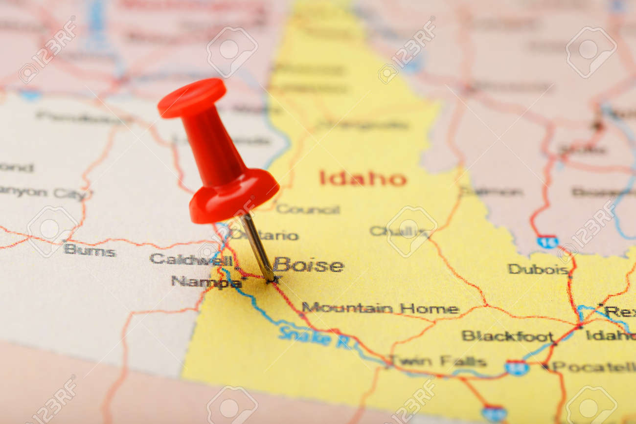 Red clerical needle on a map of USA, Idaho and the capital Boise...