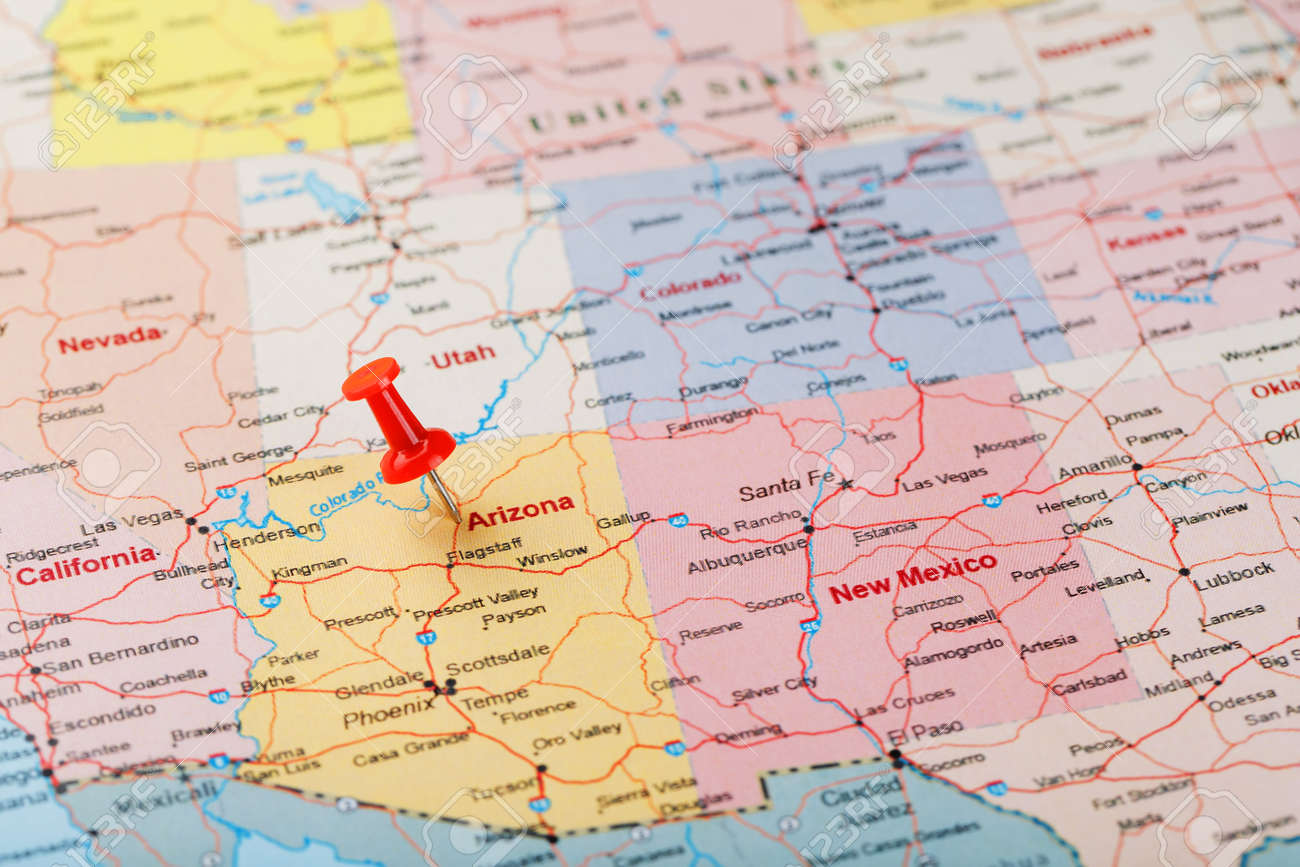 Red clerical needle on a map of USA, Arizona and the capital..