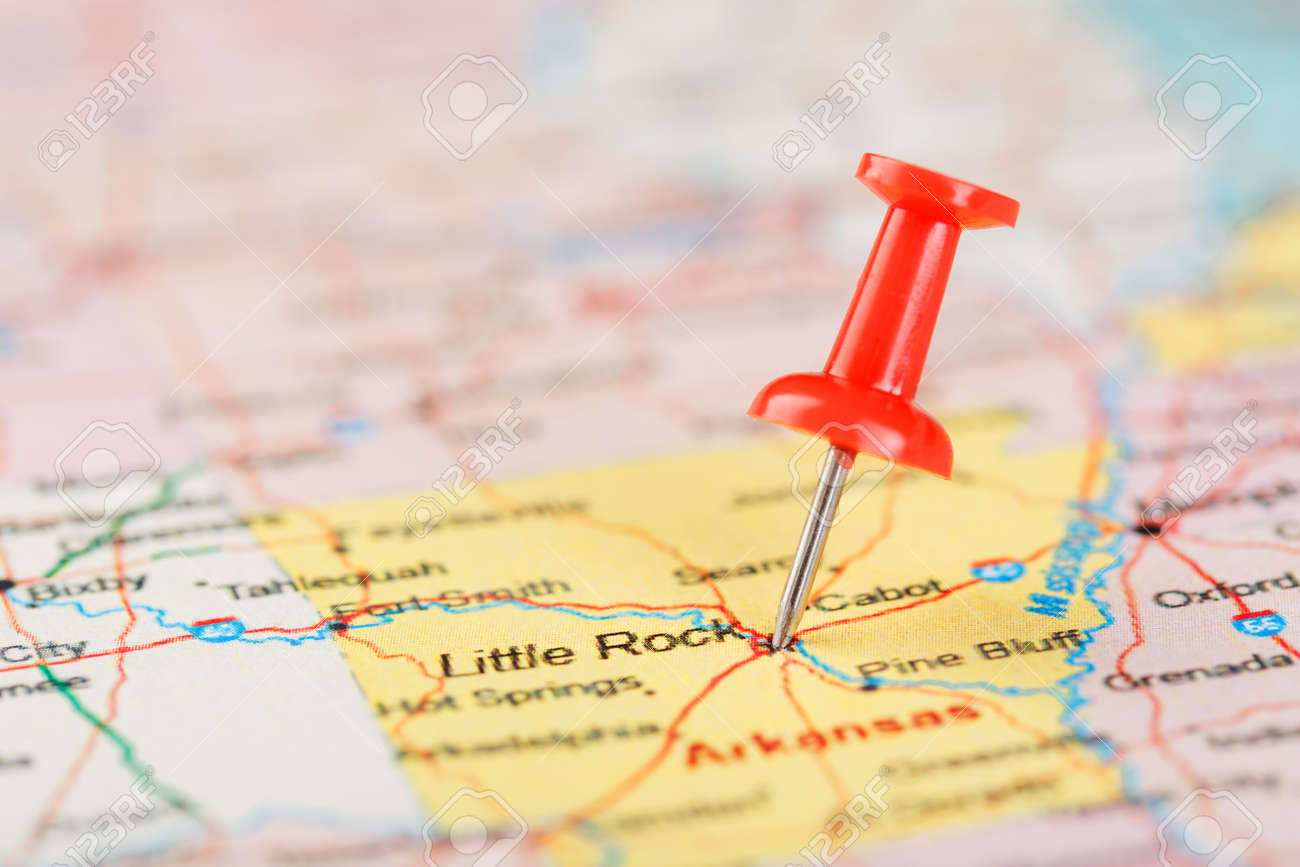 Red clerical needle on a map of USA, Arkansas and the capital..