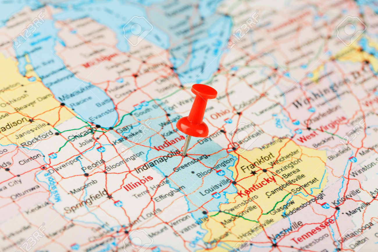 Red clerical needle on a map of USA, Indiana and the capital..