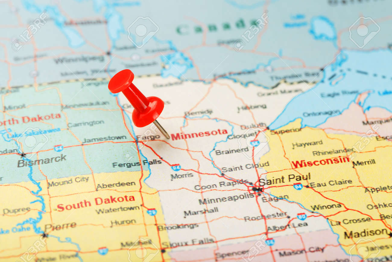 Red clerical needle on a map of USA, Minnesota and the capital..