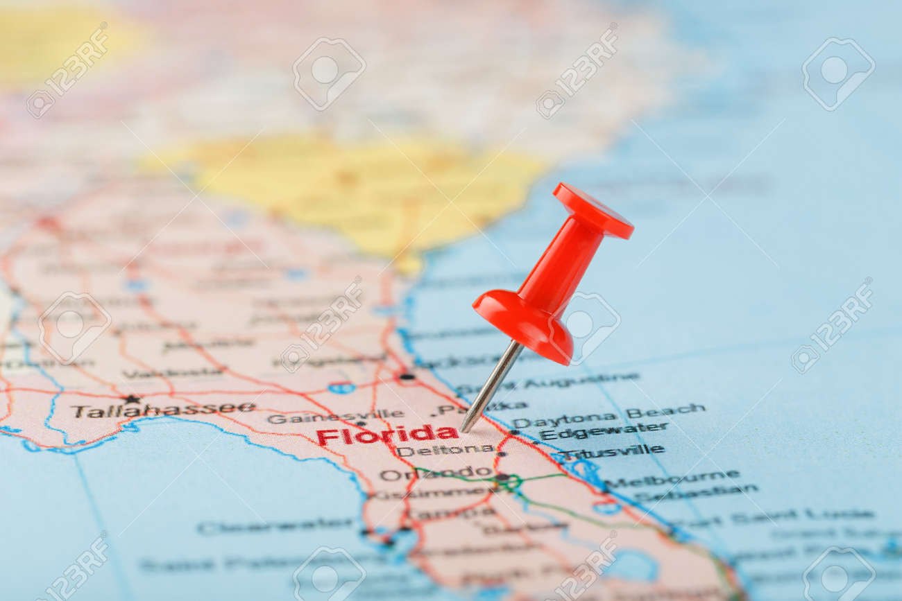 Red clerical needle on a map of USA, South Florida and the capital..