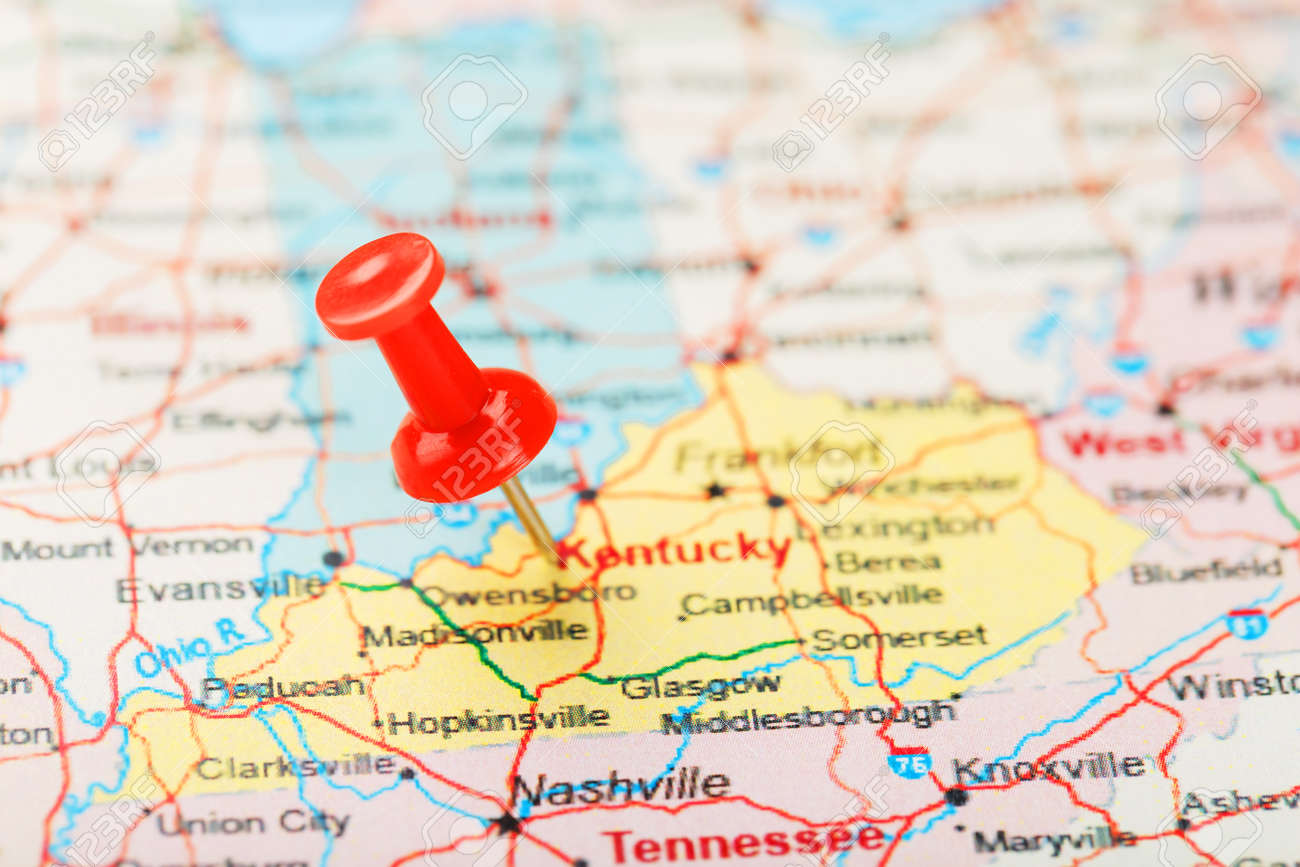 Red clerical needle on a map of USA, South Kentucky and the capital..