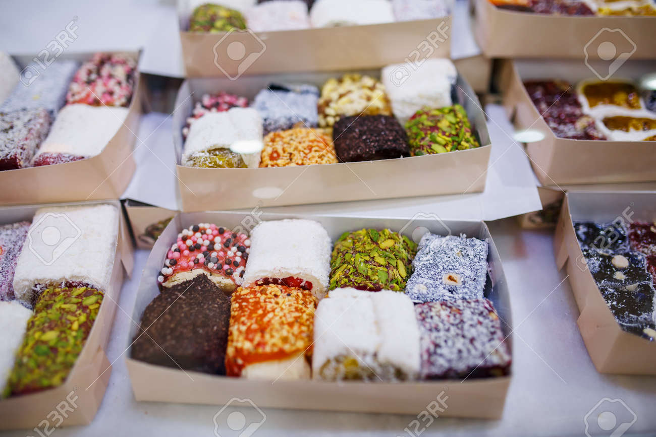 Eastern sweets, confectionery on the counter, Sherbet, Dzhezerye, halva, Turkish delight baklava. Istanbul the capital of Turkey - 132117521