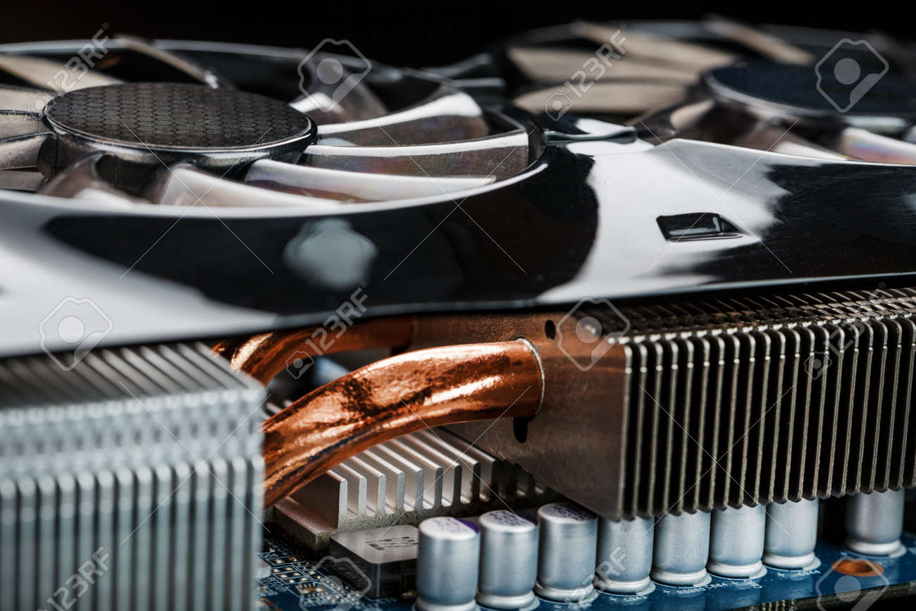 Video card with a cooling system with copper pipes, aluminum radiators and fans. Video chip for gaming and cryptocurrency mining. Dark key - 169206466