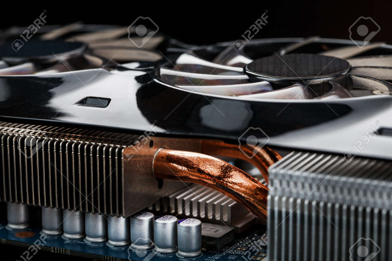 Video card cooling system with copper pipes, aluminum radiators and fans. Video chip for gaming and cryptocurrency mining. Dark key - 169206472