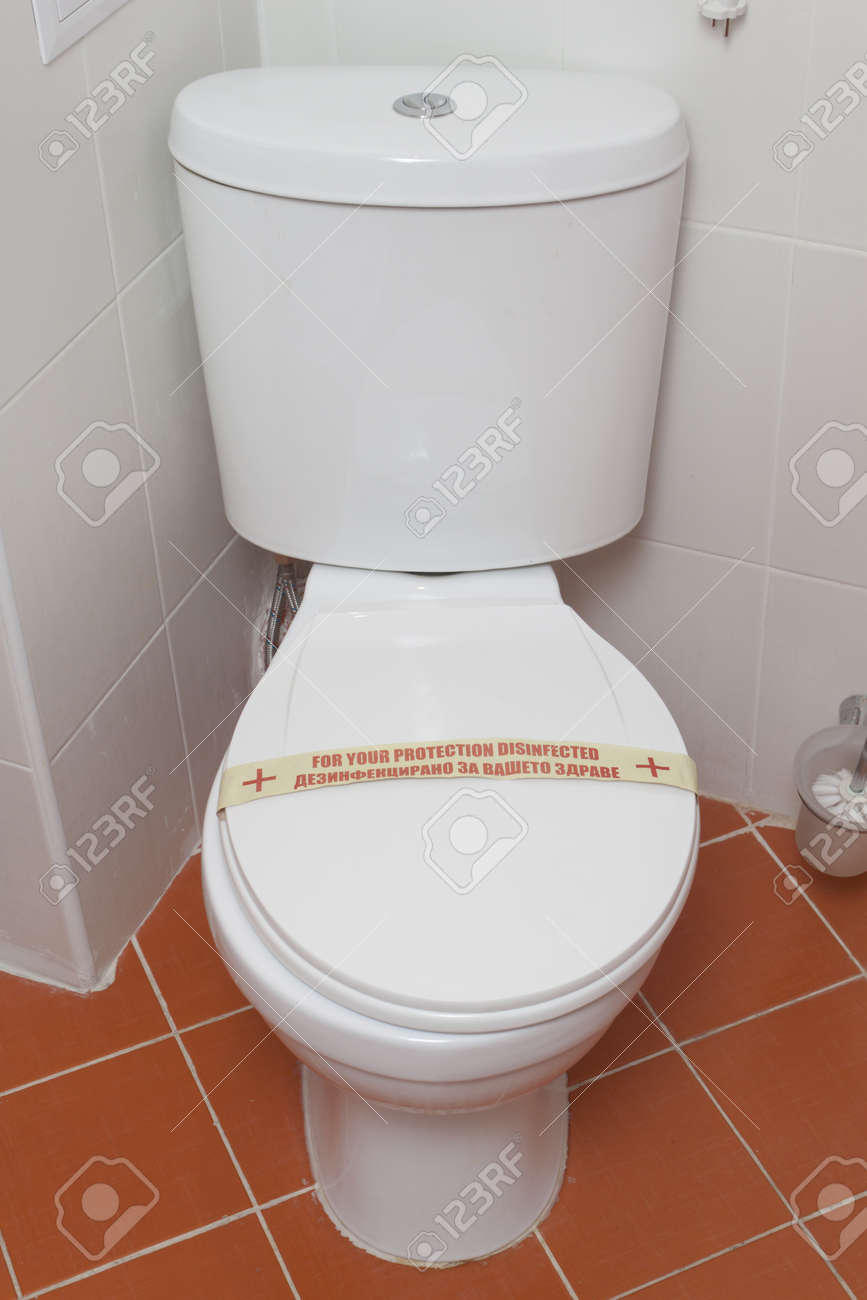 Bathroom Toilet In Hotel. Interior. Red Tiles And White Toilet ...