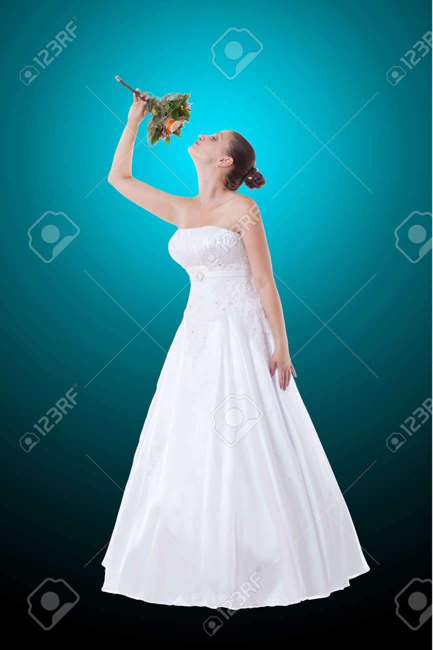Bride in white dress with bouquet on blue black backdrop Stock Photo - 14680172