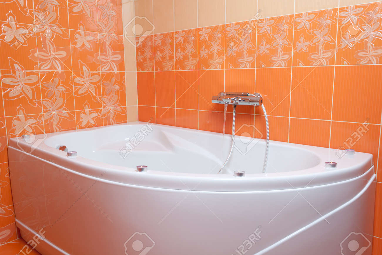 Bath Tub With Candles In New Orange Bathroom Stock Photo, Picture ...