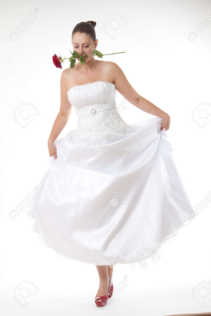 Bride in white with high heel red shoes Stock Photo - 23780910