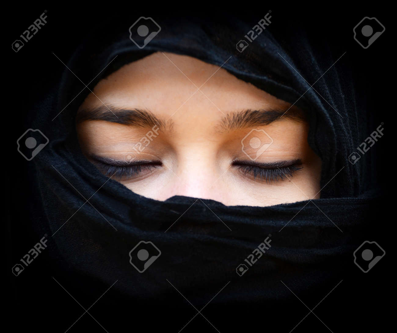 Portait of woman wearing scarf with eyes closed Stock Photo - 16335104