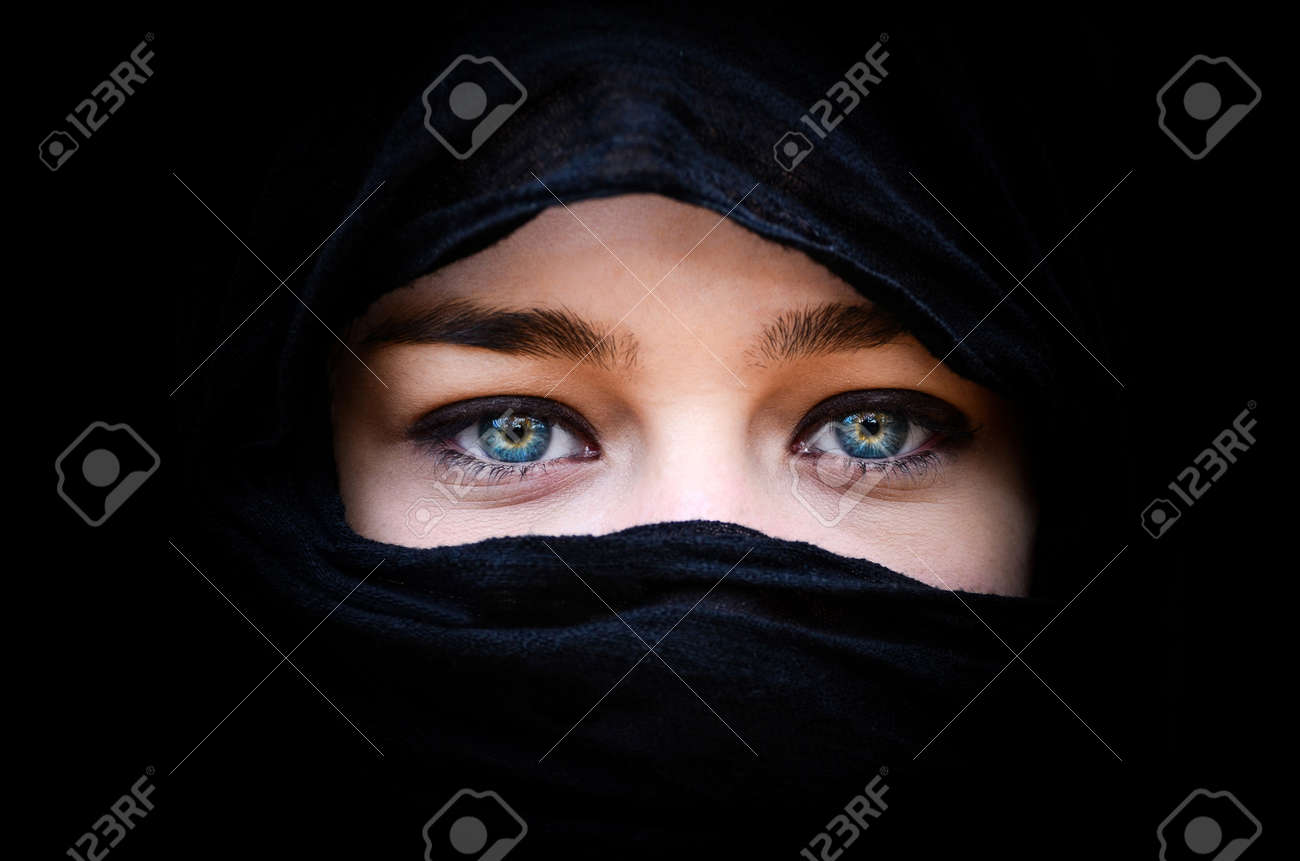 Portrait of beautiful woman with blue eyes wearing black scarf Stock Photo - 16335106