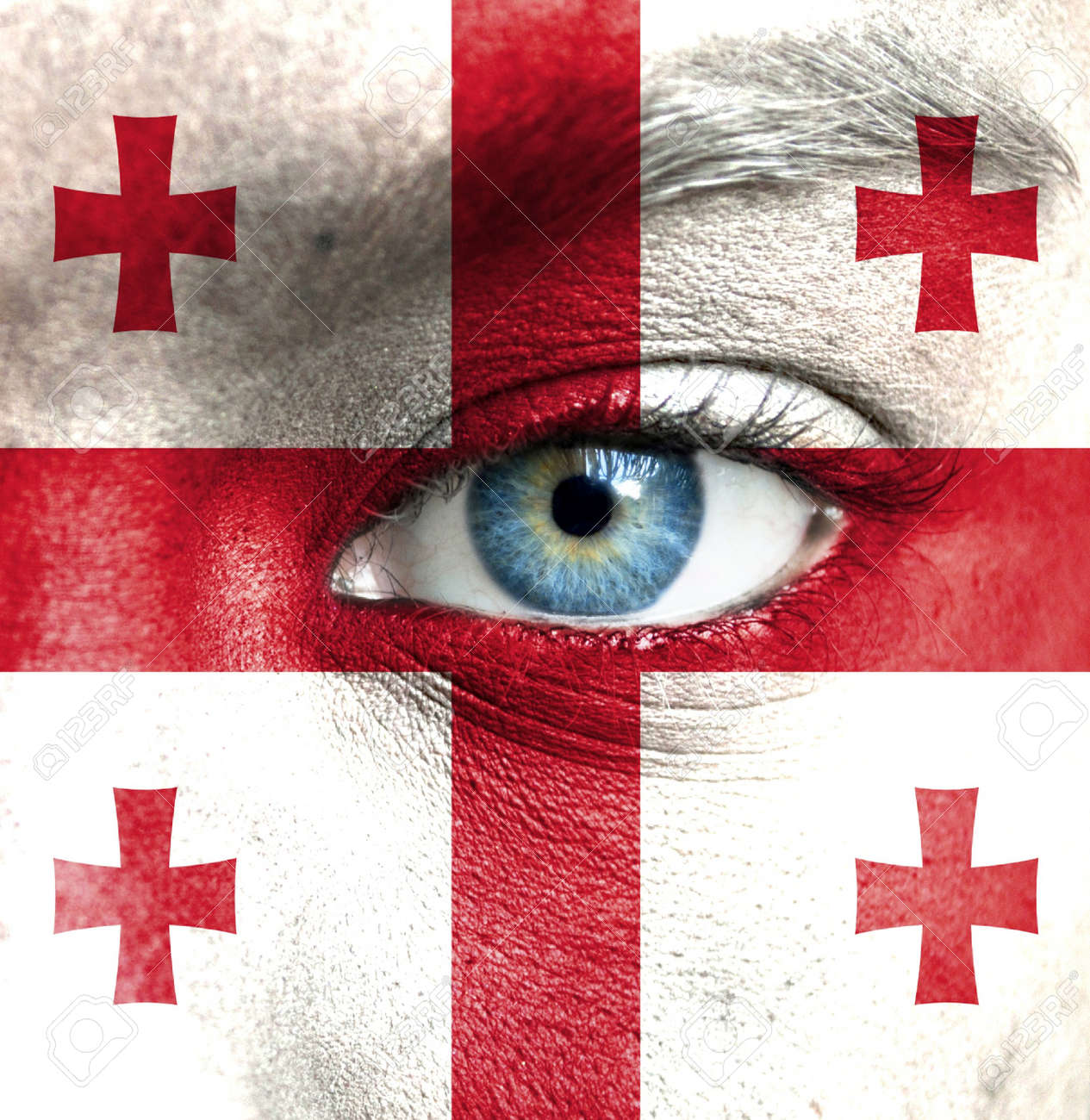 Human face painted with flag of Georgia Stock Photo - 16523487