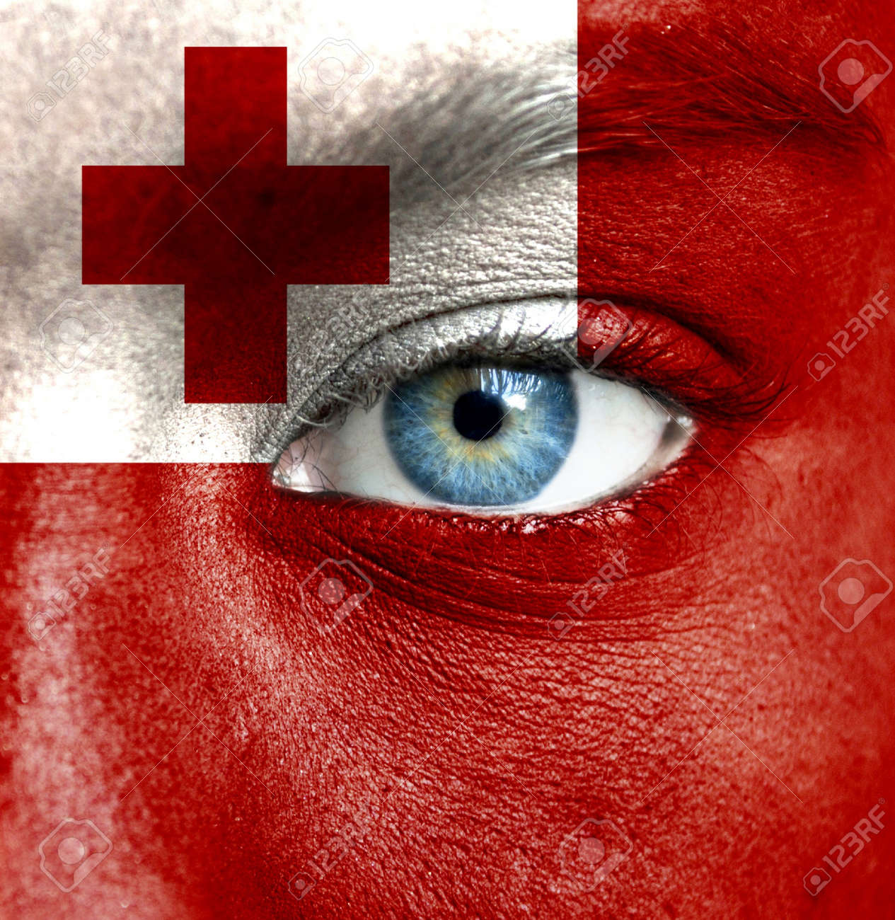 Human face painted with flag of Tonga Stock Photo - 16523643